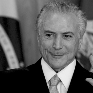 Brazil's acting President Michel Temer arrives to speak in Planalto presidential palace in Brasilia, Brazil, Thursday, May 12, 2016, after the Senate voted to suspend President Dilma Rousseff pending an impeachment trial. In his first words to Brazilians as acting president, the former vice president said his priority will be reviving Latin America's largest economy. (AP Photo/Felipe Dana)